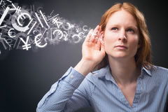 Businesswoman Listens to Financial Data Stock Photo