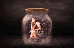 Businesswoman locked into a jar with question marks concept Royalty Free Stock Photo
