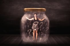Businesswoman locked into a jar with question marks concept Royalty Free Stock Photography