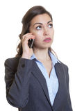 Businesswoman with long brown hair listening at phone Stock Photos