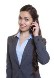 Businesswoman with long brown hair at phone Stock Photos