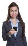 Businesswoman with long brown hair writing message with phone Stock Photos