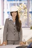 Businesswoman with long dark hair in hardhat stock photos