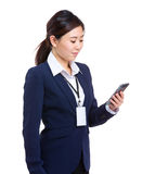 Businesswoman look at cellphone stock photos