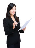 Businesswoman look at paper Royalty Free Stock Image