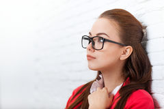Businesswoman look up to copy space wear red jacket glasses seriuos think Royalty Free Stock Photos