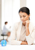Businesswoman looking at alarm clock Stock Images
