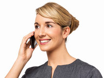 Businesswoman Looking Away While Answering Smart Phone Stock Image
