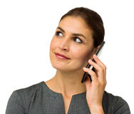 Businesswoman Looking Away While Answering Smart Phone Royalty Free Stock Image
