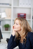 Businesswoman Looking Away In Office Stock Image