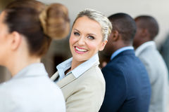 Businesswoman looking back. Pretty middle aged businesswoman looking back stock images