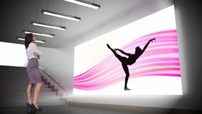 Businesswoman looking at ballerina silhouette stock video footage