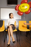 Businesswoman looking at balloon Royalty Free Stock Photos