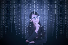 Businesswoman looking at binary code Royalty Free Stock Photo