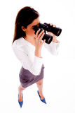 Businesswoman looking through binocular Stock Images