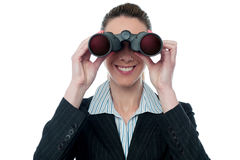 Businesswoman looking through binocular Stock Photography