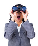 Businesswoman looking through binoculars Royalty Free Stock Photography