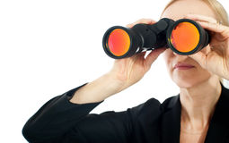 Businesswoman looking through binoculars Stock Photography