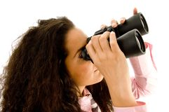 Businesswoman looking through binoculars Stock Image