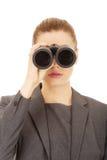 Businesswoman looking through binoculars. Royalty Free Stock Photo