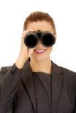 Businesswoman looking through binoculars. Royalty Free Stock Images