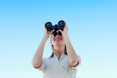 Businesswoman looking through binoculars outdoors Stock Photography