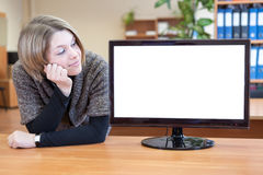 Businesswoman looking at blank white monitor Stock Image
