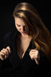 Businesswoman looking on breasts Stock Images