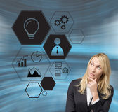 Businesswoman looking on business icon Stock Image