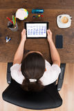 Businesswoman Looking At Calendar On Digital Tablet Royalty Free Stock Photo