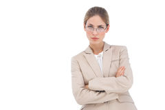 Businesswoman looking at the camera with arms crossed Stock Photos