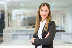 Businesswoman looking at camera in an office Stock Image