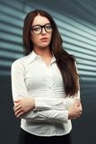 Businesswoman looking at camera Royalty Free Stock Photos