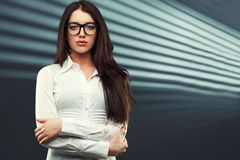 Businesswoman looking at camera Stock Photos