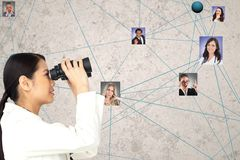 Businesswoman looking at candidates through binoculars royalty free stock photography
