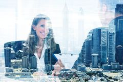 Businesswoman Looking At Colleague Over City Background royalty free stock photos