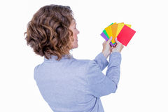 Businesswoman looking at colors cards Royalty Free Stock Photo