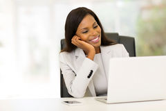Businesswoman looking at computer Royalty Free Stock Photography