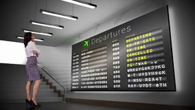 Businesswoman looking at departures board stock footage