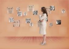 Businesswoman looking at digital interface stock photos