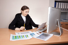 Businesswoman looking  on documents badly Royalty Free Stock Photography