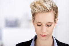 Businesswoman Looking Down In Office Stock Images