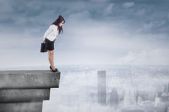 Businesswoman looking down from the rooftop Royalty Free Stock Photos