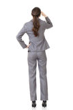 Businesswoman looking far away Royalty Free Stock Image