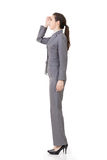 Businesswoman looking far away Stock Photo