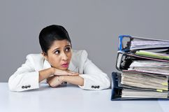 Businesswoman looking at files. And thinking Royalty Free Stock Photo