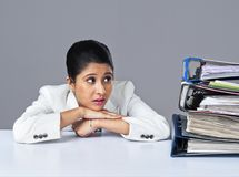 Businesswoman looking at files and thinking Royalty Free Stock Photo