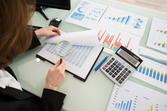 Businesswoman Looking At Financial Report Stock Photos