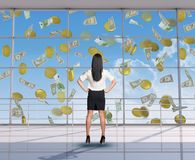Businesswoman looking at flying money Stock Photos