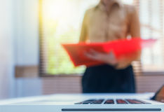 Businesswoman looking for folder about meeting subject on document, business content, business background . Stock Photo